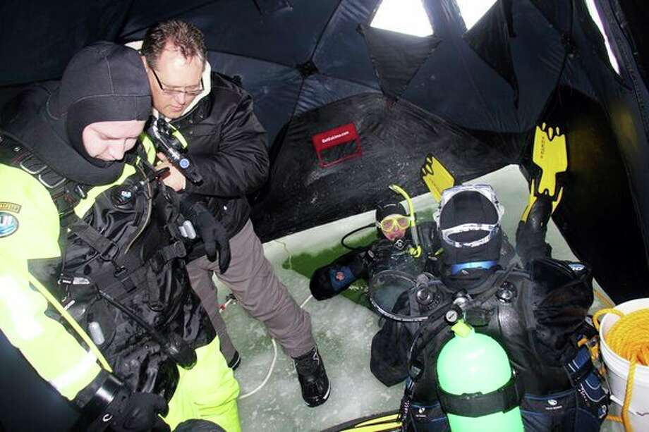 Divers from theHuron and Tuscola county sheriff's offices conducted ice dive training this week in Wild Fowl Bay off of Sand Point. (Seth Stapleton/Huron Daily Tribune)