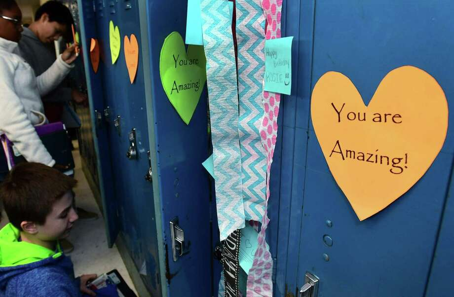 "Roton Middle School 7th and 8th graders go to their lockers on Wednesday. Roton Middle School recently implemented a social emotional learning curriculum and in conjunction the PTA came up with ""Roton's Lockers of Love"". The hearts are inscribed with inspiring messages on all of the school's 550 lockers to make the middle students feel positive and good about themselves. Photo: Erik Trautmann / Hearst Connecticut Media / Norwalk Hour"