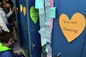 "Roton Middle School 7th and 8th graders go to their lockers on Wednesday. Roton Middle School recently implemented a social emotional learning curriculum and in conjunction the PTA came up with ""Roton's Lockers of Love"". The hearts are inscribed with inspiring messages on all of the school's 550 lockers to make the middle students feel positive and good about themselves."