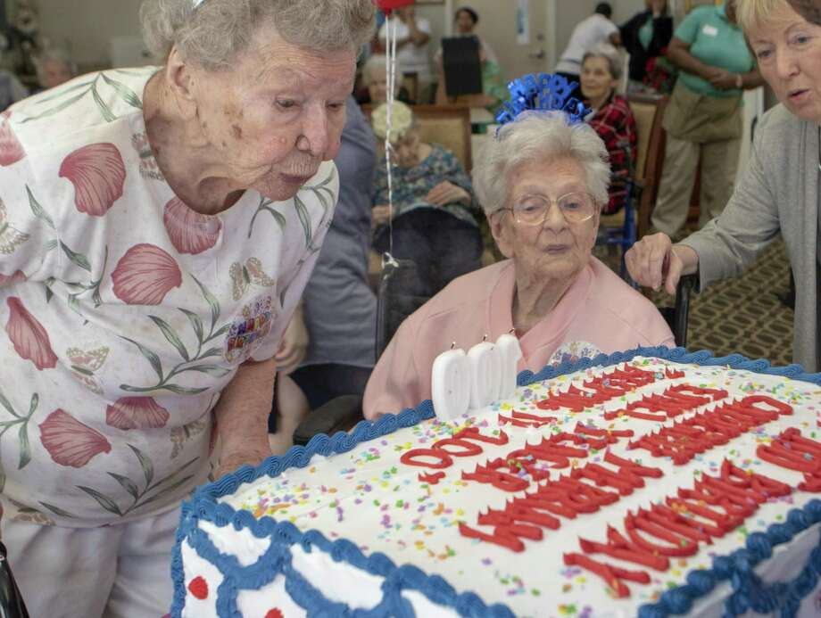 Catherine Merriam Left And Ethel Yeager Blow Out The Candles On Their 100th Birthday