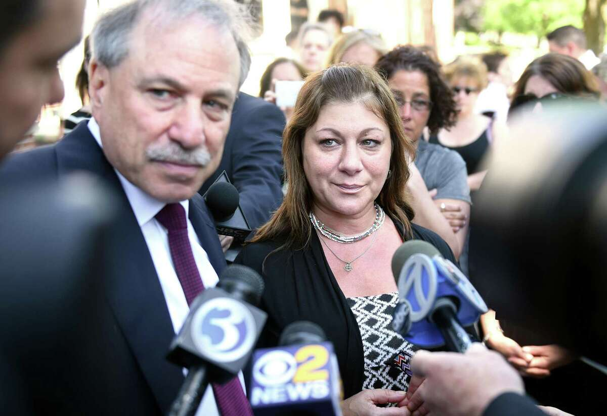 Donna Cimarelli-Sanchez, center, mother of Maren Sanchez, speaks with the press accompanied by her attorney David Golub outside Superior Court in Milford after the sentencing of Christopher Plaskon in June 2016.