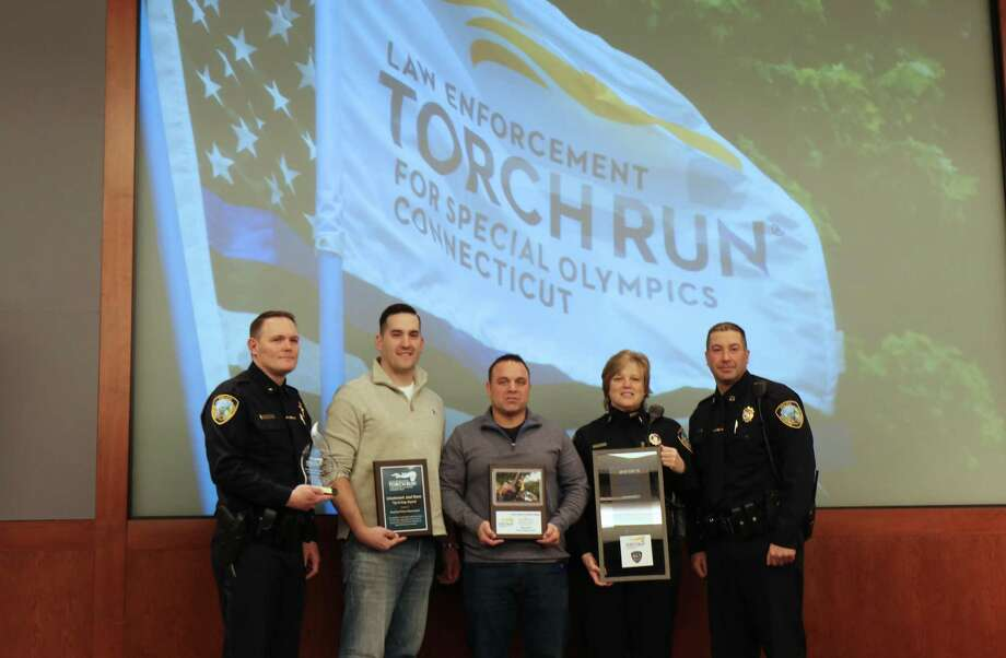 The Branford Police Department was honored by Special Olympics Connecticut recently as the top fundraising police department in 2018, raising more than $40,000 for Special Olympics athletes in Connecticut. Accepting the award, from left, are Deputy Chief Jonathan Mulhern, Officer Joe Harrington, Officer Joe Herten,  Lt. Kris Hormuth and  Capt. John Alves. Photo: Contributed Photo / Special Olympics Connecticut