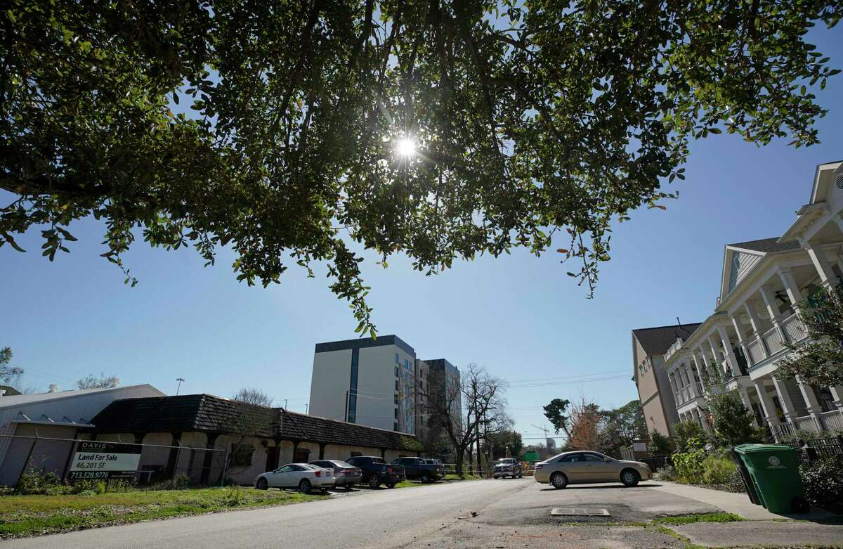 The property at 402 Columbia, left, is the site where a developer is proposing an affordable housing complex shown Wednesday, Feb. 13, 2019, in Houston.
