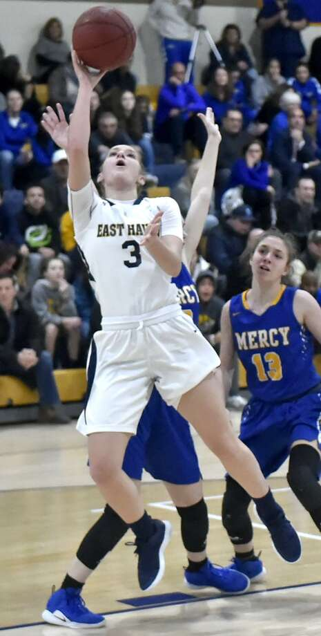 East Haven's Makenzie Helms puts up a shot against Mercy on Monday at East Haven High. Photo: Peter Hvizdak / Hearst Connecticut Media / New Haven Register
