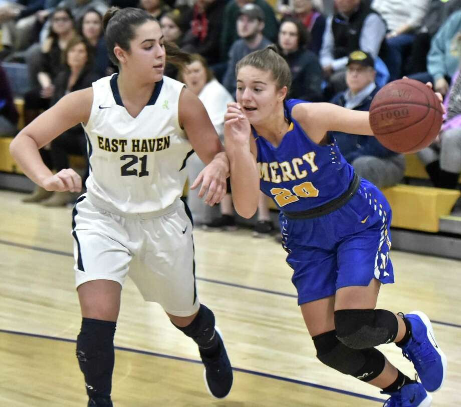 Mercy's Kameryn King drives to the basket in front of East Haven's Isabella Ragaini during Monday's game in East Haven. Photo: Peter Hvizdak / Hearst Connecticut Media / New Haven Register