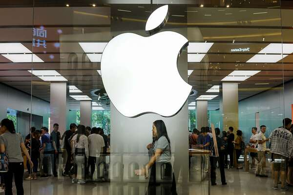 (FILES) In this file photo taken on September 21, 2017, costumers shop at an Apple showroom in Shanghai. - Chinese engineer Jizhong Chen was charged with stealing secrets from a stealth self-driving vehicle project at Apple, a freshly unsealed criminal complaint revealed. (Photo by CHANDAN KHANNA / AFP)CHANDAN KHANNA/AFP/Getty Images