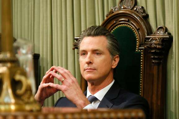 Gov. Gavin Newsom listens in to Lieutenant Gov. Eleni Kounalakis at the State of the State address at the California State Capitol on Tuesday, Feb. 12, 2019, in Sacramento.