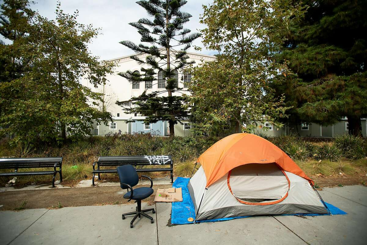 A tent rests adjacent to the Lake Merritt Community Cabins site in Oakland, Calif., on Tuesday, Oct. 2, 2018. The city plans to house up to 40 homeless people in the sheds as part of it's third Community Cabins site.