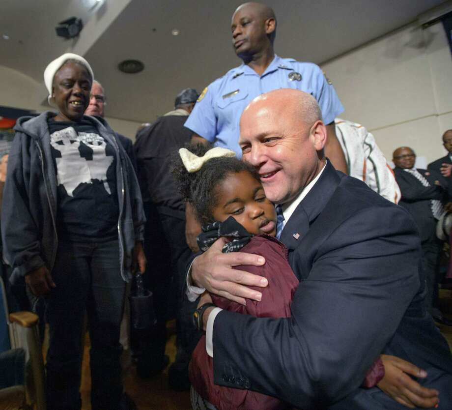 New Orleans Mayor Mitch Landrieu hugs Markey Hagen, 4, after the vote in 2015 to remove Confederate monuments. He is morally unambiguous without dehumanizing his opponents. Photo: Associated Press File Photo / The New Orleans Advocate