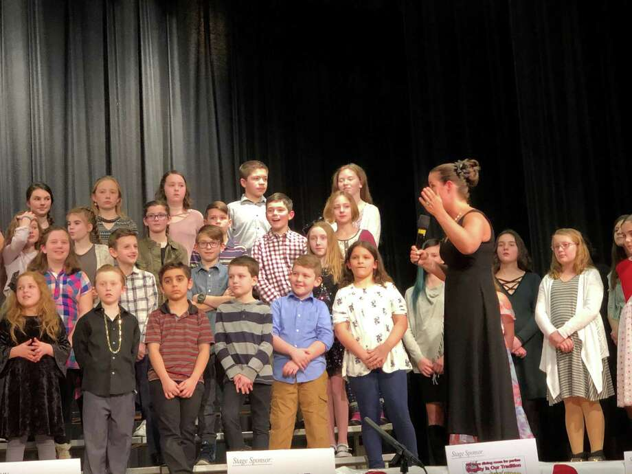 Scenes from the 2018 St. Jude's Telethon at Torrington High School include a local children's choral performance. The 40th annual event is set for Sunday, March 3. Photo: Contributed Photo /