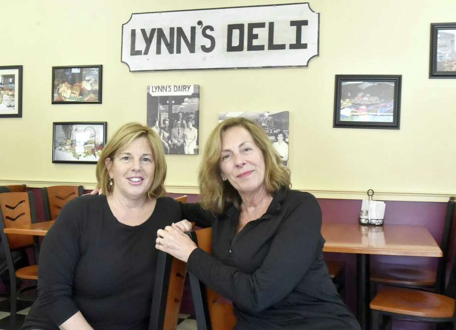 Lynn DeMusis-Grady, left, and sister Helen Borrelli, right, owners of Lynn's Restaurant and Deli in Branford. Photo: Peter Hvizdak / Hearst Connecticut Media / New Haven Register