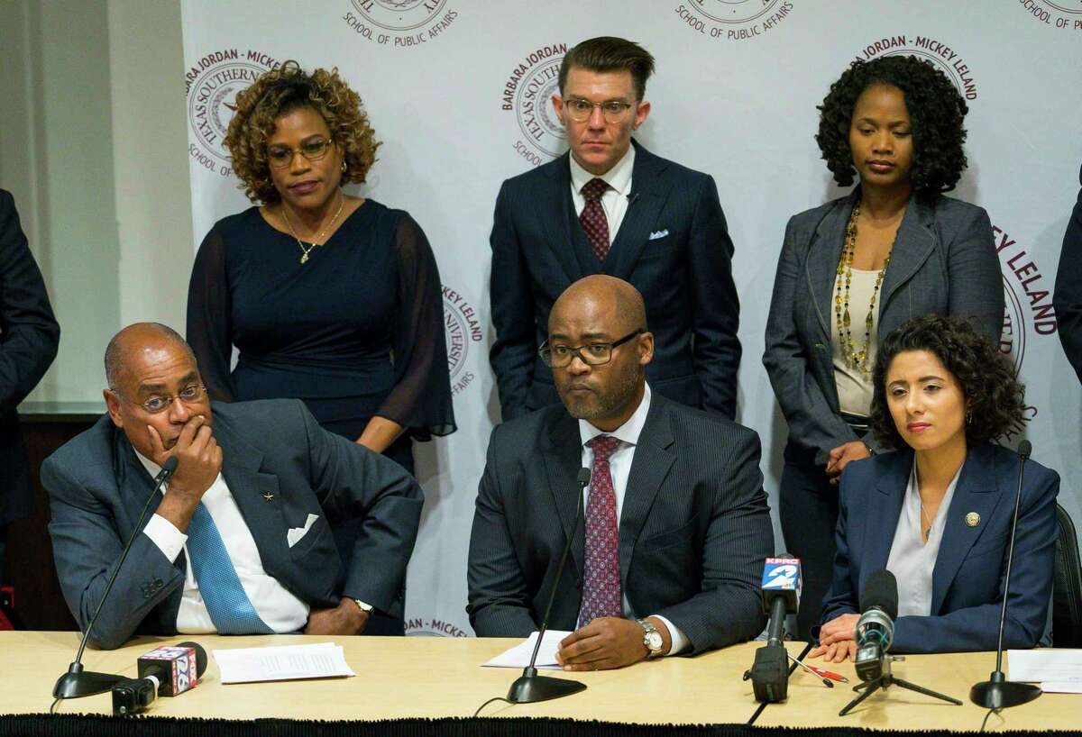 Darrell Jordan, presiding judge of the Harris County Criminal Courts of Law, center, along with Harris County Commissioner Rodney Ellis, left, and County Judge Lina Hidalgo, right, are among criminal justice reform advocates who want the county to abolish its system of having judges appoint lawyers for indigent defendants.