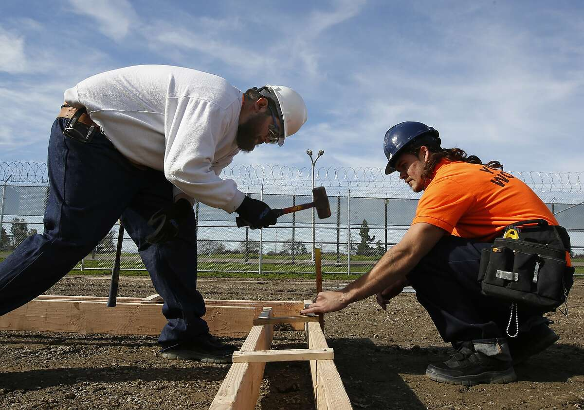Youth offenders Siegmond Navar, left and Gabriel Andalon construct a concrete frame at one of the vocational classes the O.H. Close Youth Correctional Facility, Tuesday, Jan. 22, 2019, in Stockton, Calif. Gov. Gavin Newsom is proposing to put California's juvenile prisons under the state's Health and Human Services Agency instead of the same agency that runs adult prisons. (AP Photo/Rich Pedroncelli)