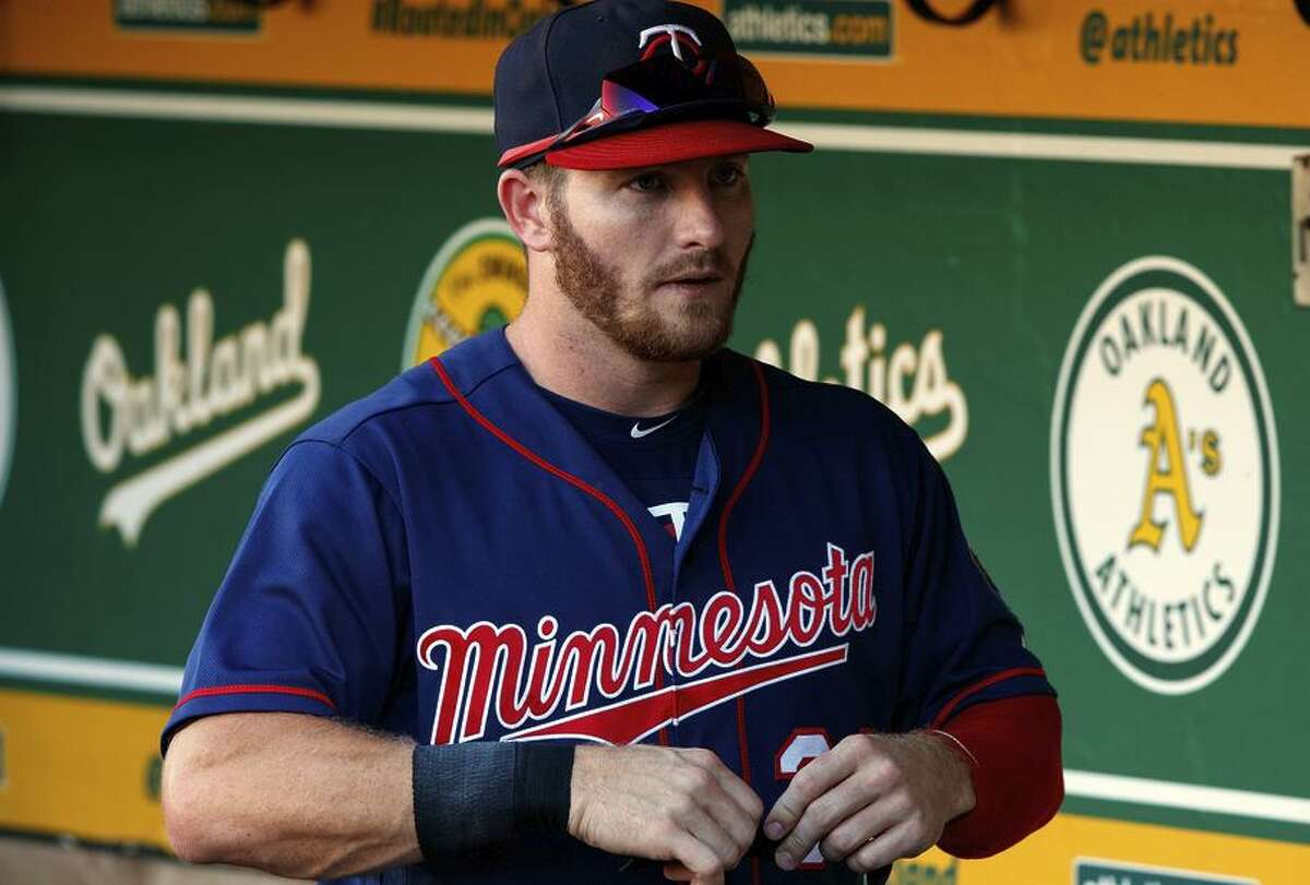 Robbie Grossman #36 of the Minnesota Twins stands in the dugout before the game against the Oakland Athletics at the Oakland Coliseum on September 22, 2018 in Oakland, California. The Oakland Athletics defeated the Minnesota Twins 3-2.