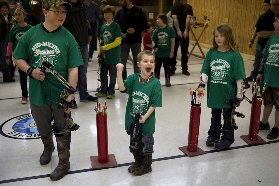 Ethan Bovee, then 5, celebrates after finding out he won a drawing during a winter youth shoot at Mid Michee Bowmen in this March 21, 2014 file photo. Photo: Daily News File Photo