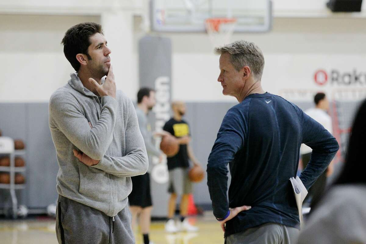 Bob Myers (l to r), general manager Golden State Warriors and Steve Kerr, head coach Golden State Warriors talk during practice at the Rakuten Performance Center on Monday, April 16, 2018, in Oakland, Calif.