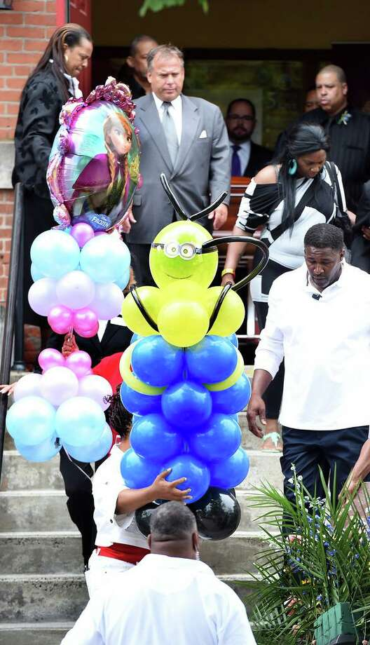 Balloon bouquets are carried for Aleisha Moore and Daaron Moore of East Haven out of Varick Memorial A.M.E. Zion Church in New Haven June 16, 2015. Photo: Arnold Gold / Hearst Connecticut Media File / New Haven Register