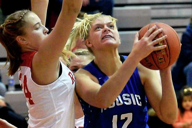 Hoosic Valley's #12 Alex Rifenburg gets past Mechanicville's #24 Maddie Shakow, left, to get off a shot during Friday night's game Dec. 14, 2018 in Mechanicville, NY. (John Carl D'Annibale/Times Union)