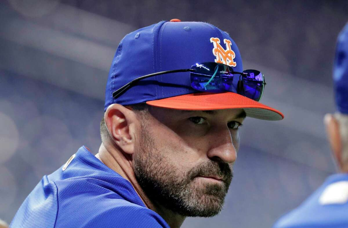 FILE - In this June 30, 2018, file photo, New York Mets manager Mickey Callaway watches batting practice before a baseball game against the Miami Marlins in Miami. Callaway is set to begin his second spring training in charge of the Mets, this time with a revamped roster under a new general manager who expects the team to contend. (AP Photo/Lynne Sladky, File)