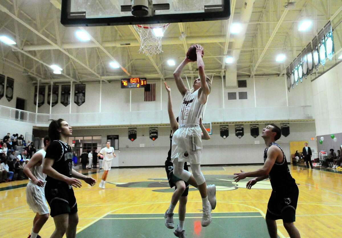 Greens Farms Academy's Jack Ramsay (12) goes up to the basket during basketball action against Hamden Hall in Hamden, Conn., on Wednesday Feb. 13, 2019.