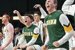 Siena's bench reacts after a basket by Kadeem Smithen during a basketball game against Iona at the Times Union Center on Wednesday, Feb. 13, 2019 in Albany, N.Y. (Lori Van Buren/Times Union)