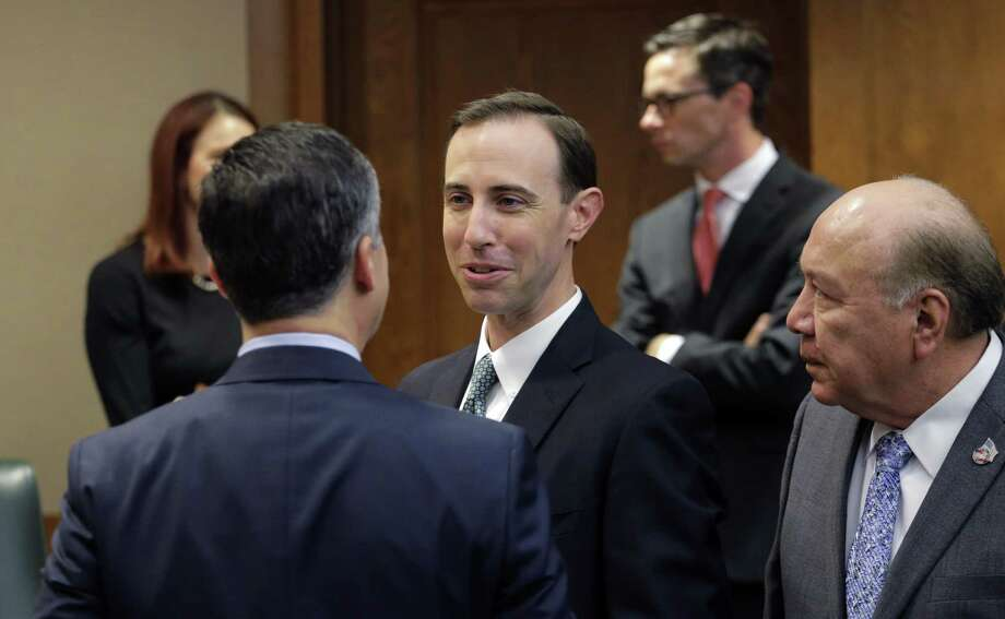 Secretary of State David Whitley, center, arrives for his confirmation hearing, Thursday, Feb. 7, 2019, in Austin, Texas, where he addressed the backlash surrounding Texas' efforts to find noncitizen voters on voter rolls. (AP Photo/Eric Gay) Photo: Eric Gay, STF / Associated Press / Copyright 2019 The Associated Press. All rights reserved.