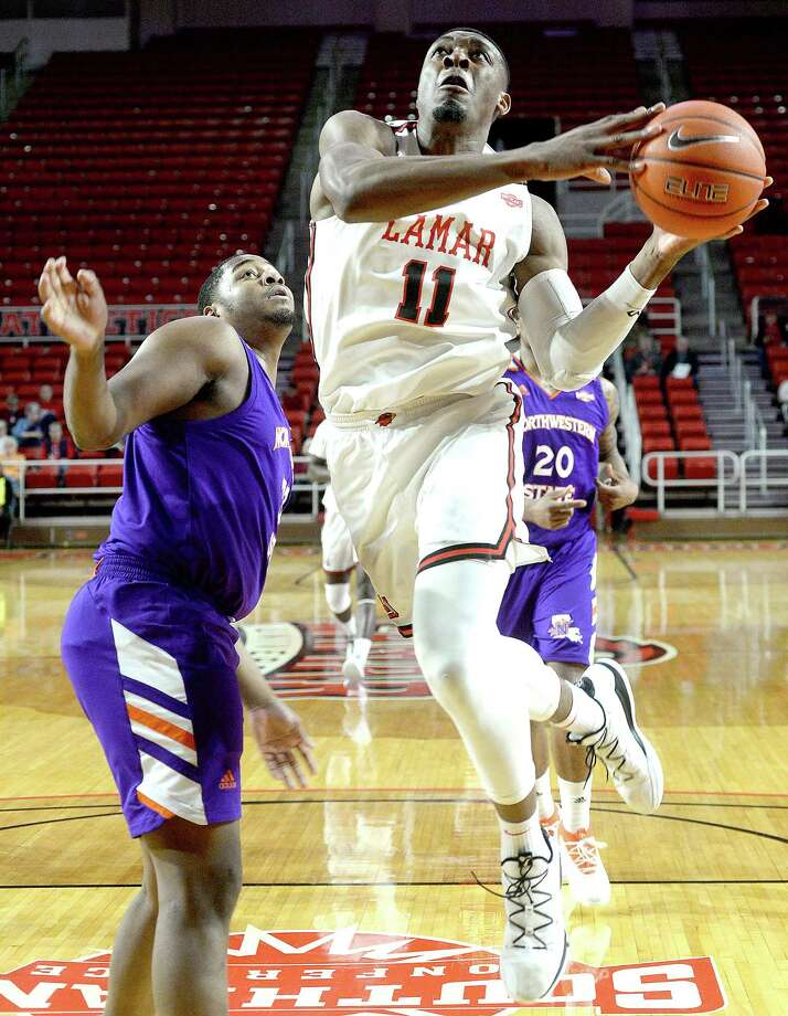 Lamar's Josh Nzeakor gets past Northwestern State's Larry Owens as he shoots for two points during their game Wednesday night at the Montagne Center. 