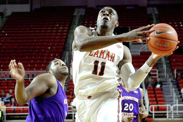 Lamar's Josh Nzeakor gets past Northwestern State's Larry Owens as he shoots for two points during their game Wednesday night at the Montagne Center. Photo taken Wednesday, February 13, 2019 Kim Brent/The Enterprise
