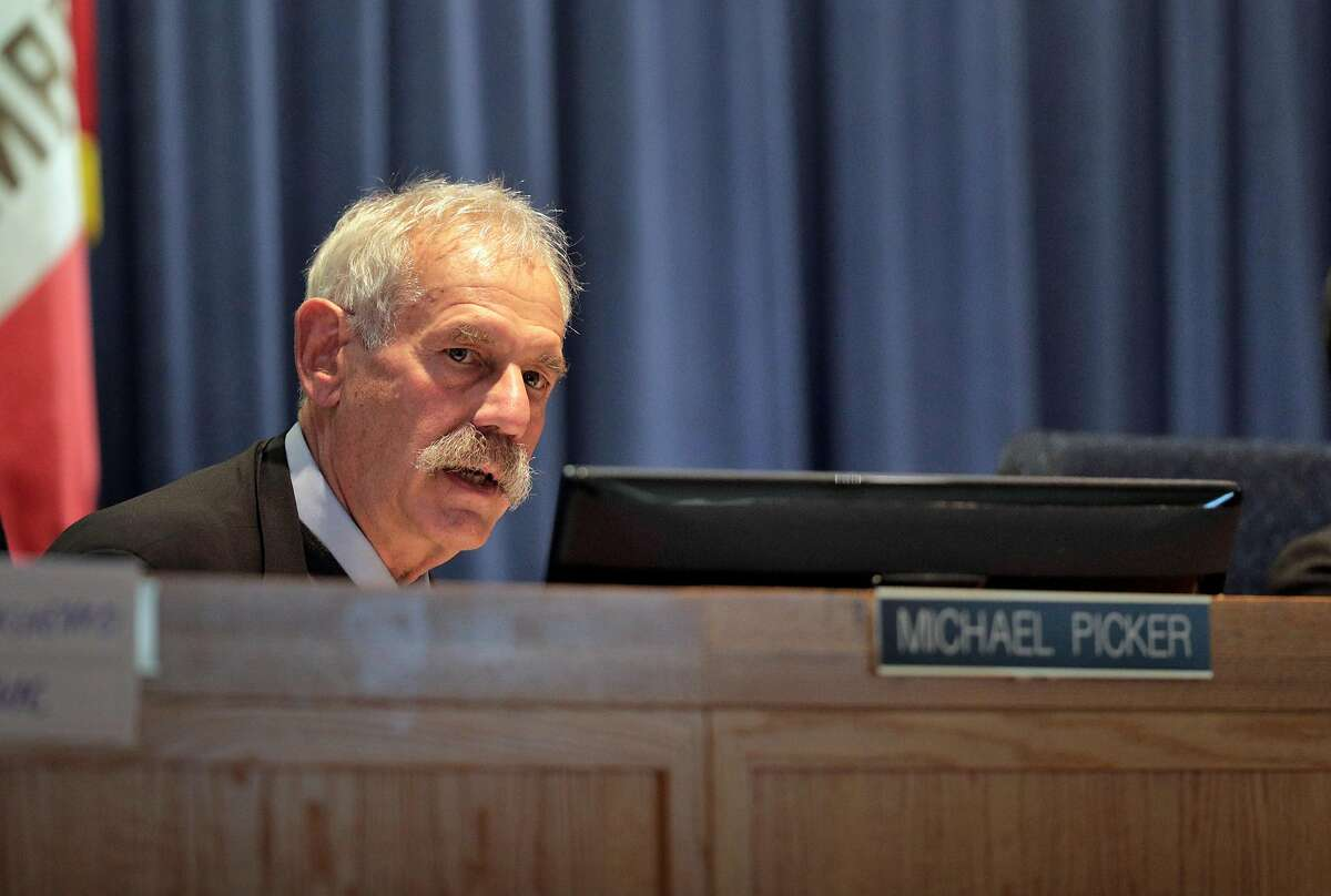 CPUC President Michael Picker asks a question of Sumeet Singh, PG&E Vice President, Community Wildfire Safety Program, during a hearing at the California Public Utilities Commission in San Francisco, Calif., on Wednesday, February 13, 2019. PG&E's presentation offered more insights about its state-mandated efforts to prevent its power lines from causing more wildfires, and outlined a massive expansion of the company's proactive power shutoffs that could impact any one of its 5 million electric customers.