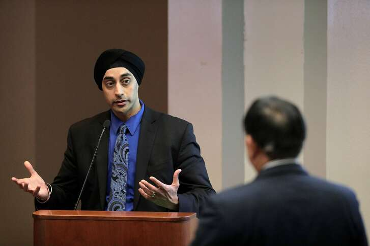 Sumeet Singh, PG&E Vice President, Community Wildfire Safety Program, gestures as he answers a questino from the public during a hearing at the California Public Utilities Commission in San Francisco, Calif., on Wednesday, February 13, 2019. PG&E's presentation offered more insights about its state-mandated efforts to prevent its power lines from causing more wildfires, and outlined a massive expansion of the company's proactive power shutoffs that could impact any one of its 5 million electric customers.