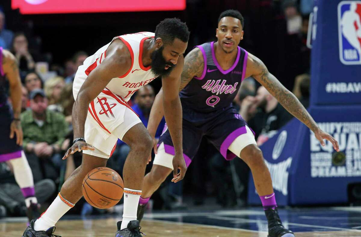 Houston Rockets' James Harden, left, dribbles as Minnesota Timberwolves' Jeff Teague defends in the first half of an NBA basketball game, Wednesday, Feb. 13, 2019, in Minneapolis. (AP Photo/Jim Mone)