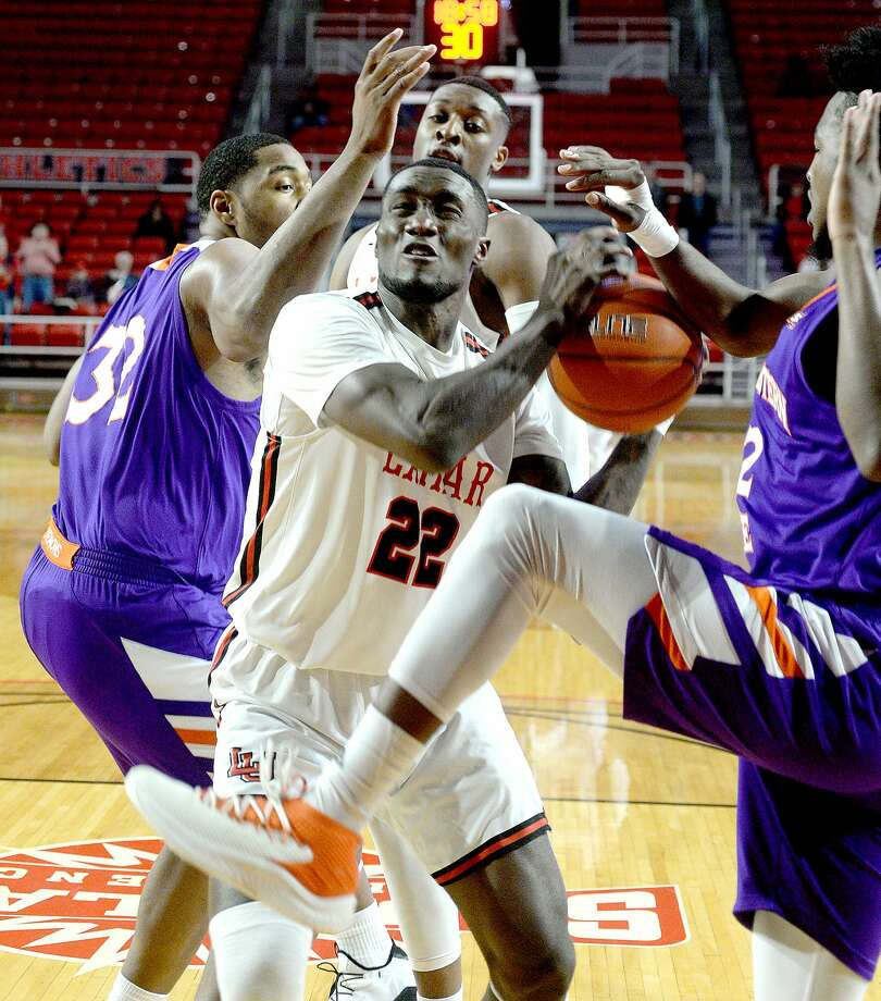 Lamar's Christian battles to piut up a shot against pressure from Northwestern State's Larry Owens and DeAndre Love during their game Wednesday night at the Montagne Center.  Photo taken Wednesday, February 13, 2019 Kim Brent/The Enterprise Photo: Kim Brent/The Enterprise