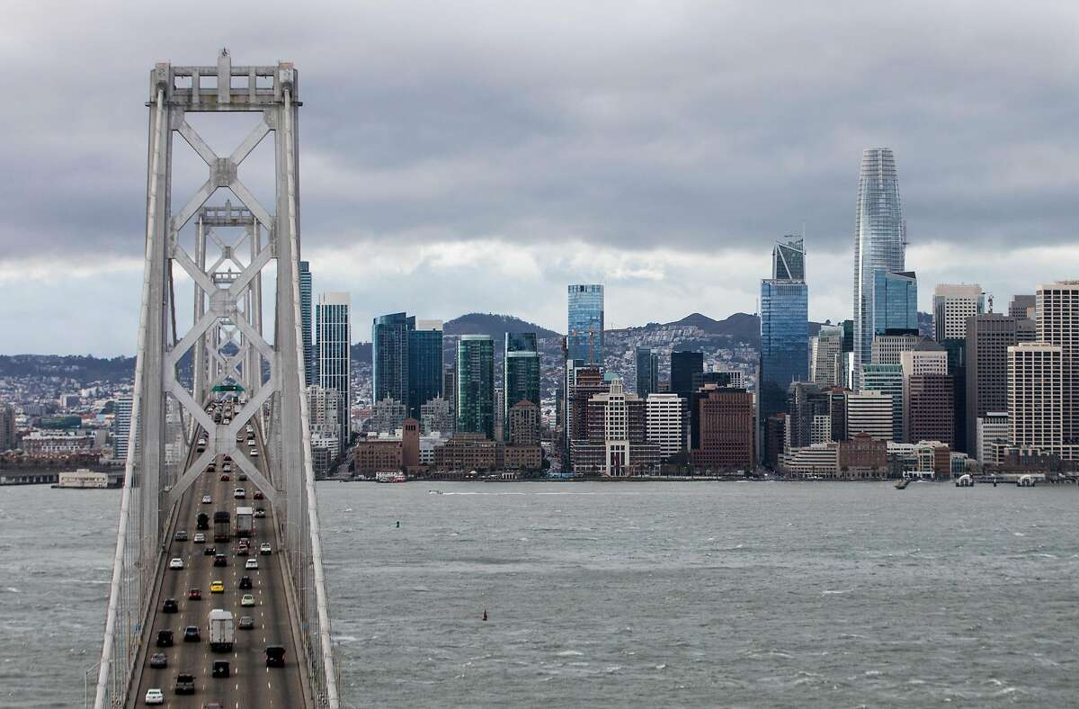 Dark clouds hang over the Bay Bridge and downtown San Francisco, Calif. Saturday, Jan. 5, 2019 as a winter storm moves through the Bay Area.