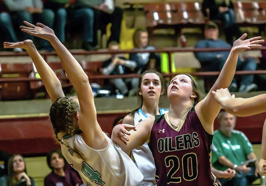 Oiler Kayla Brantley and Jersey's Lauren Brown prepare to battle for a rebound Wednesday night during semifinal action at the Wood river Class 3A Regional at EA-WR. Photo: Nathan Woodside | The Telegraph