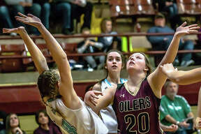 Oiler Kayla Brantley and Jersey's Lauren Brown prepare to battle for a rebound Wednesday night during semifinal action at the Wood river Class 3A Regional at EA-WR.