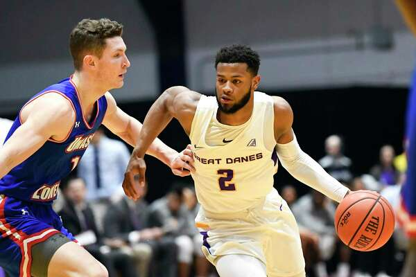 University of Massachusetts guard Bryce Daley (1) defends against University at Albany guard Ahmad Clark (2) during the first half of an NCAA men's college basketball game Wednesday, Feb. 13, 2019, in Albany, N.Y. (Hans Pennink / Special to the Times Union)