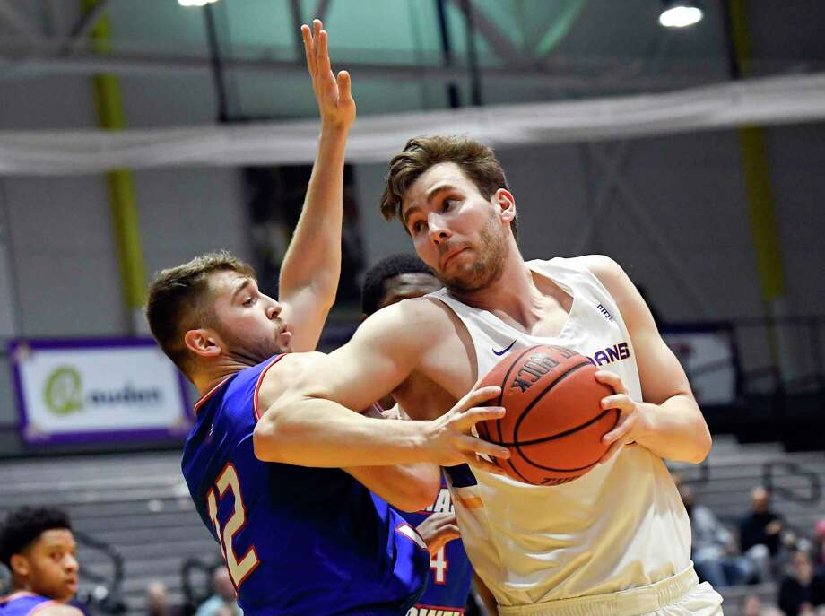 University of Massachusetts guard Josh Gantz (12) defends against University at Albany forward Adam Lulka (14) during the first half of an NCAA men's college basketball game Wednesday, Feb. 13, 2019, in Albany, N.Y. (Hans Pennink / Special to the Times Union) Photo: Hans Pennink / 20045814A
