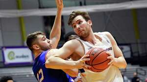 University of Massachusetts guard Josh Gantz (12) defends against University at Albany forward Adam Lulka (14) during the first half of an NCAA men's college basketball game Wednesday, Feb. 13, 2019, in Albany, N.Y. (Hans Pennink / Special to the Times Union)