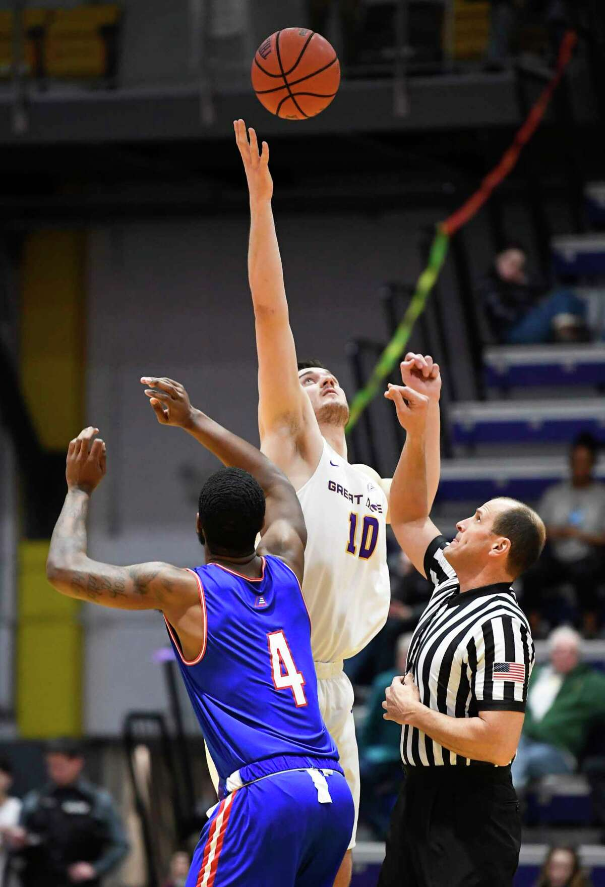 University at Albany forward Brent Hank (10) wins the opening tipoff against University of Massachusetts forward Darius Henderson (4) during the first half of an NCAA men's college basketball game Wednesday, Feb. 13, 2019, in Albany, N.Y. (Hans Pennink / Special to the Times Union)