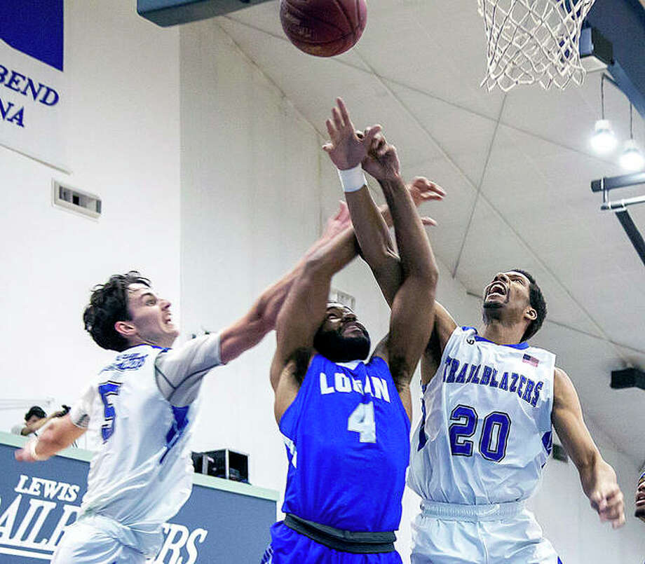 LCCC's Ben Wright (5) and Malachi Ross (20) battle for the ball with Logan's Mark Lancaster (4) in Wednesday's night's game at the River Bend Arena. Photo: Jan Dona | For The Telegraph