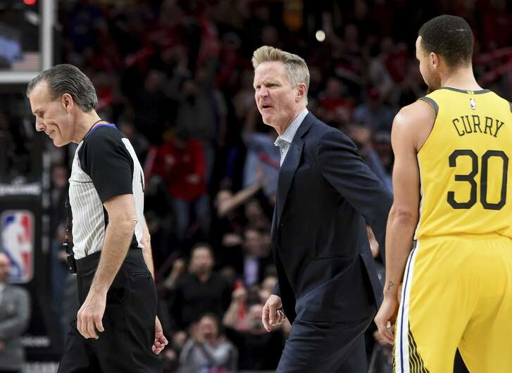 Warriors coach Steve Kerr, center, yells at referee Ken Mauer, left, after being called for a technical foul, while guard Stephen Curry, right, watches during the second half.