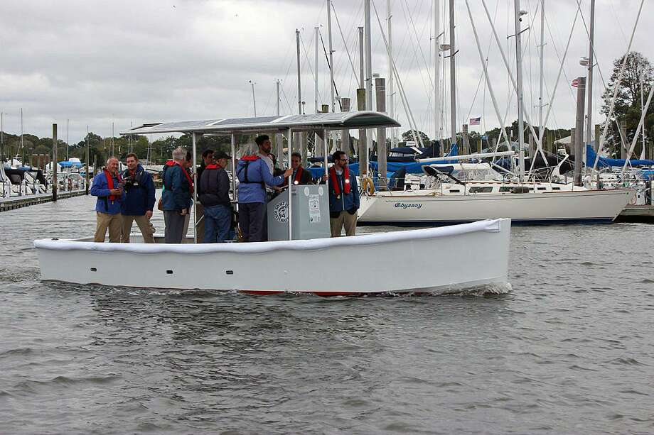 On Monday, Oct. 15, 2018, DEEP launched the world's first full-sized pumpout boat, photographed here. Photo: Contributed Photo / DEEP / Contributed Photo / Connecticut Post Contributed