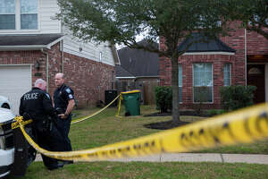 Pearland Police officers investigate the scene where three people were fatally shot on the 2000 block of Creek Run Drive Thursday, Feb. 14, 2019, in Pearland, Texas.