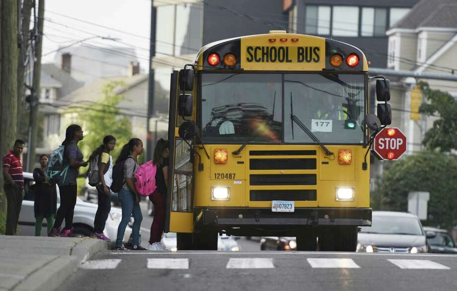 Some parents are concerned that motorists too frequently pass buses that have stop signs extended, causing safety risks to children. Photo: Tyler Sizemore / Hearst Connecticut Media / Greenwich Time