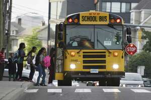 Some parents are concerned that motorists too frequently pass buses that have stop signs extended, causing safety risks to children.