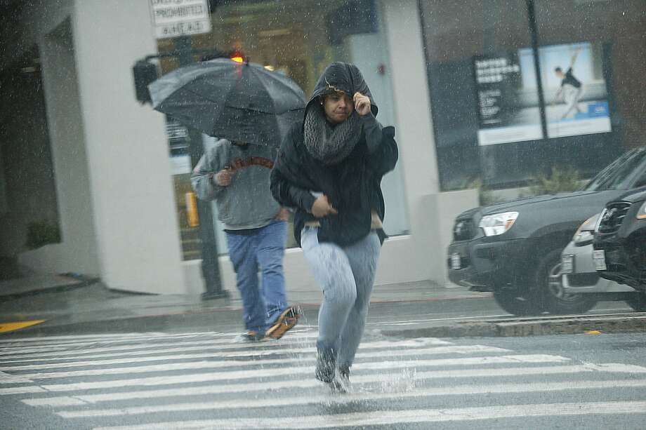 A woman makes her way through a storm on Wednesday, Feb. 13, 2019, in San Francisco, Calif. Photo: Santiago Mejia / The Chronicle
