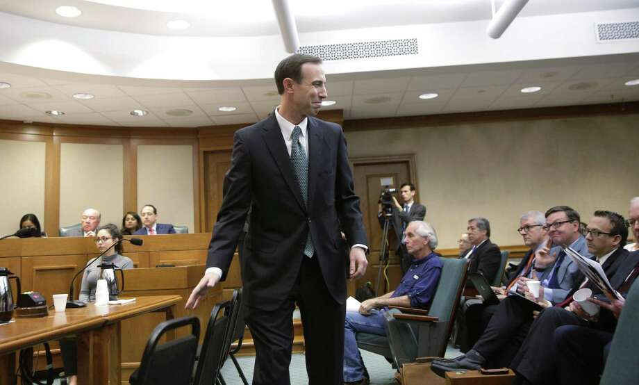 Secretary of State David Whitley, center, attends his confirmation hearing, Thursday, Feb. 7, 2019, in Austin, Texas, where he addressed the backlash surrounding Texas' efforts to find noncitizen voters on voter rolls. (AP Photo/Eric Gay) Photo: Eric Gay, STF / Associated Press / Copyright 2019 The Associated Press. All rights reserved.