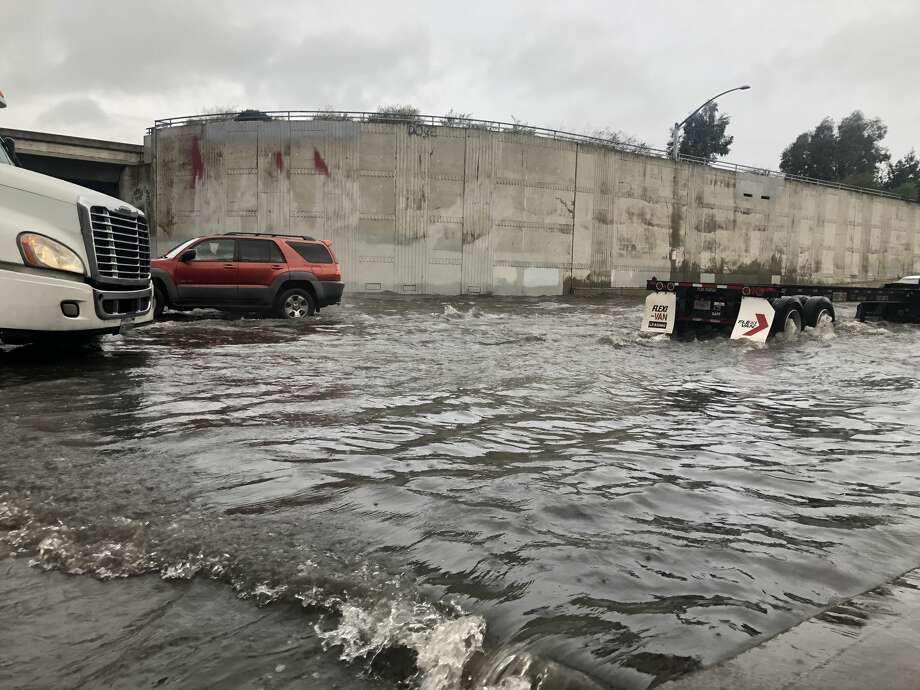 Formidable flooding was visible under the Nimitz Freeway overpass near 7th Street in West Oakland on February 14, 2019 as storms lashed the Bay Area for the second day. Photo: Alix Martichoux/SFGATE