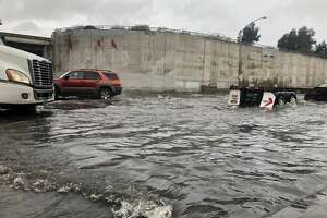 Formidable flooding was visible under the Nimitz Freeway overpass near 7th Street in West Oakland on February 14, 2019 as storms lashed the Bay Area for the second day.