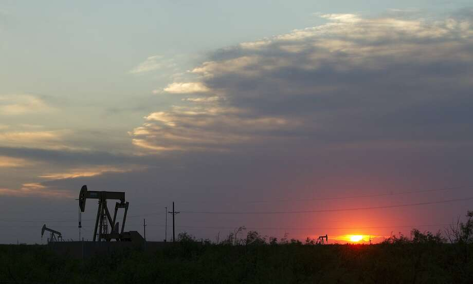 The sun sets behind a group of pump jacks Wednesday, June 1, 2011, outside of Midland. ( Brett Coomer / Houston Chronicle ) Photo: Brett Coomer, Houston Chronicle